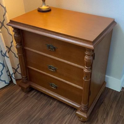 A wooden dresser repaired by Furniture Care of Texas.